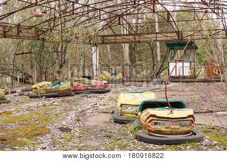 Rusted bumper cars in Pripyat city, Ukraine