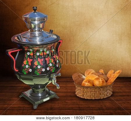 On the wooden surface of the table is a samovar decorated with beautiful pattern and wicker basket with white bread.
