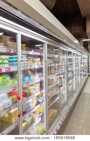 FRANCE, GRENOBLE- MAY 8, 2016: Shelves with goods in food supermarket