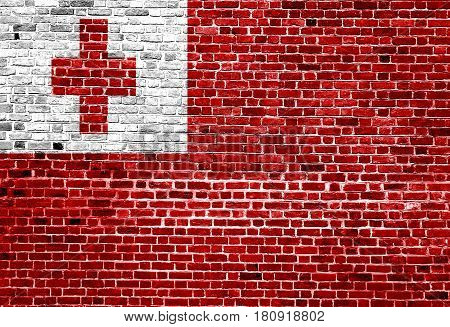 Flag of Tonga painted on brick wall, background texture