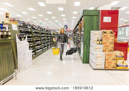 ITALY, MILAN- MAY 11, 2016: Consumers in Lidl supermarket. Lidl is a global discount supermarket chain