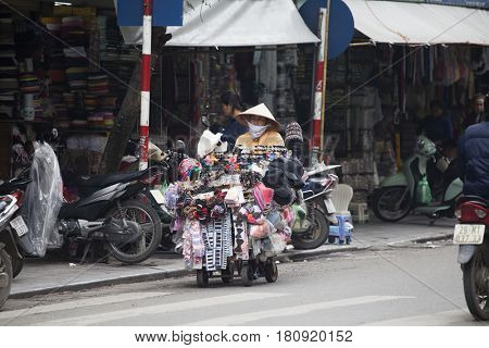 Hanoi, Vietnam - March 9, 2017:  Street life in Hanoi. Street vendors selling their products on the busy streets of Hanoi.