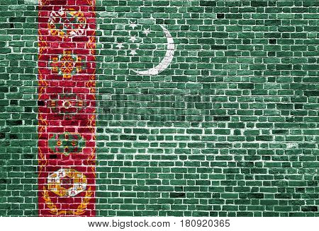Flag of Turkmenistan painted on brick wall, background texture