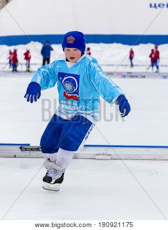 RUSSIA, KOROLEV- FEBRUARY 18, 2017: Young hockey player have a warm up training before the match on bandy tournament