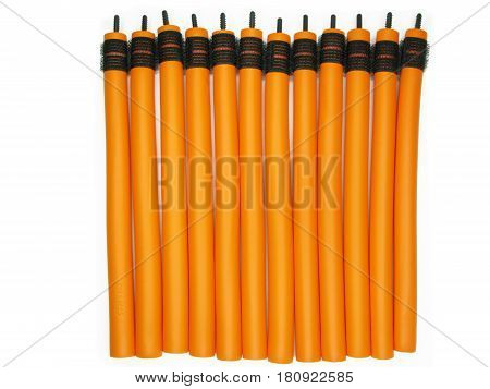 collection of orange hair rolls isolated set
