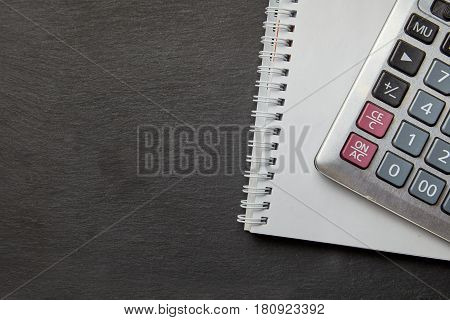 Office black table with calculator, notepad. Top view with copy space