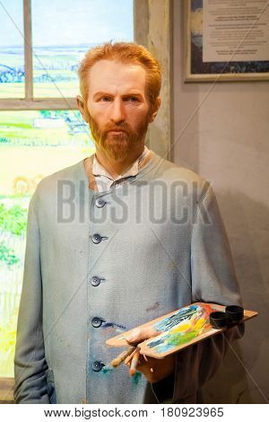 Amsterdam, Netherlands - March, 2017: Wax figure of Vincent Willem van Gogh, dutch post-impressionist painter in Madame Tussauds Wax museum in Amsterdam, Netherlands