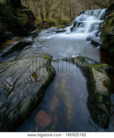 Rocks in front of the Sgwd y Pannwr waterfall Brecon Beacons Wales