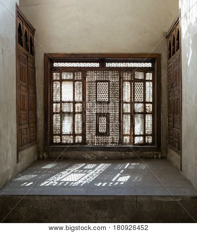 Cairo, Egypt - February 25, 2017: Interleaved wooden window (Mashrabiya) with built-in couch Medieval Cairo Egypt