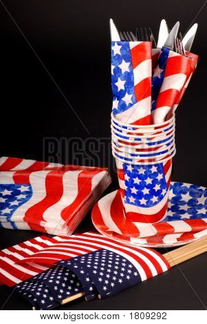 4Th Of July Tablesetting With Cups, Napkins, Flags And Silverware