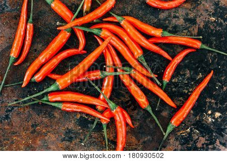 Red Hot Chili Peppers Over Rustic Surface - Fresh And Organic.