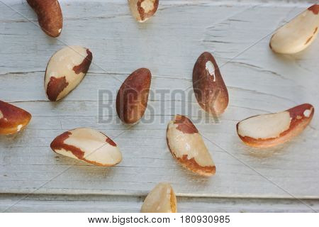 Brazil Nuts Over The White Wooden Table.