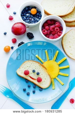 Fruit dessert for children in funny form breakfast fun idea for kids