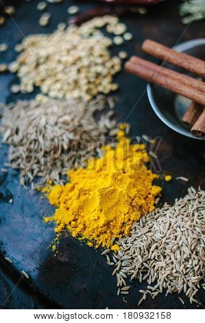 Turmeric Powder Spice On Black, Surrounded By Other Spices.