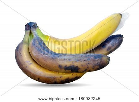 Condom on a yellow banana among rotting on a white background. The concept of protected sex