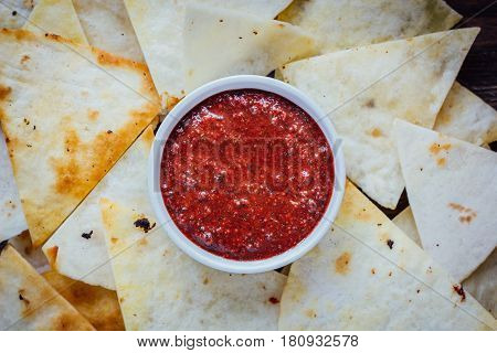 Hot Salsa Dip Over The Hip Of Nachos Chips - Organic Home Made Sauce.