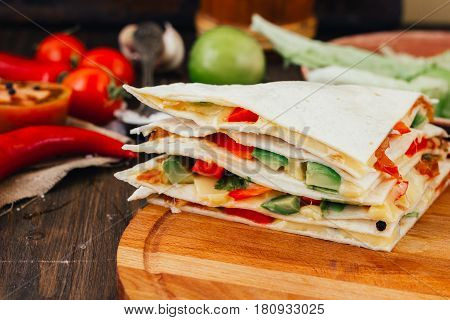 Nice Vegetarian Quesadilla With Tortilla Bread, Beans, Cheese And Vegetables.