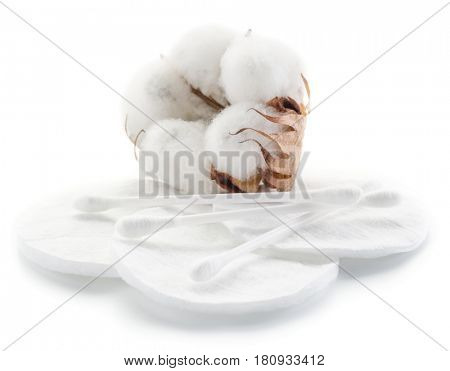 Fluffy cotton ball and cotton swabs and pads on a white background.