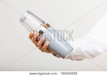 Flair bartending alcohol liquor party relax concept. Shaking glass and shaker. Person holding two tools making cocktail.