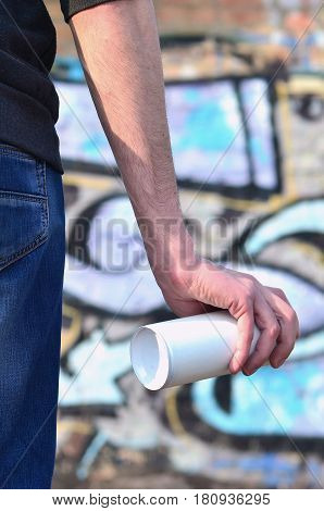 Rear View Of A Guy Drawing A Wall With Aerosol Paint
