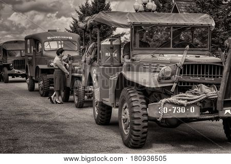 HASTINGS MN - JULY 30 2016: World War II era Jeeps wait in line for parade with military re-enactors accompanying them. Jeeps went into production in 1941 specifically for the US military.