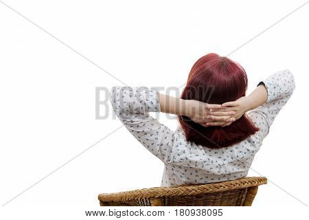 Rear view of a young woman relaxing her hands crossed behind her head looking and imagine something over white background.Relaxing body and calming mind.