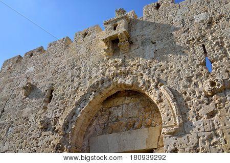 Damaged upper fragment of Zion Gate in Old City of Jerusalem Israel.
