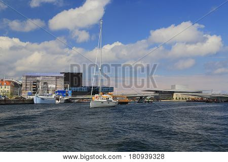 COPENHAGEN, DENMARK - JUNE 29, 2016: It is the city's harbor between Opera House and Theatrical House.