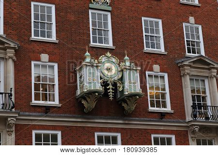 LONDON, GREAT BRITAIN - SEPTEMBER 20, 2014: This is the clock above the entrance to the Fortunum and Mason store on Piccadilly Street.