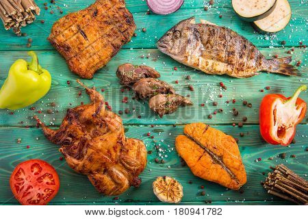 Meat allsorts from different types of meat and fish with the vegetables and spices fried on coals