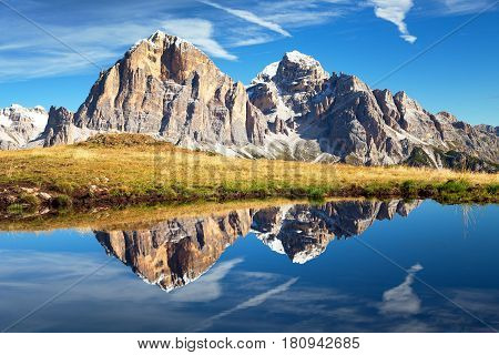 View from passo Giau Tofana or Le Tofane Gruppe mountain mirroring in lake Dolomites Italy