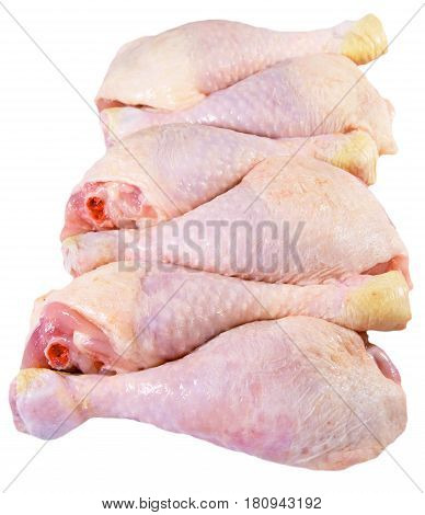 Six raw chicken legs isolated on a white background