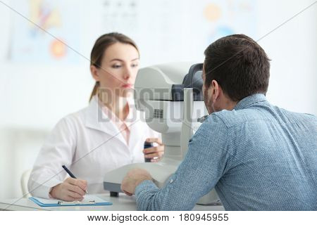 Female doctor examining adult male patient