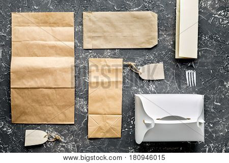delivery service set with paper bags on gray desk background top view mock up