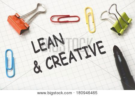 Lean And Creative Concept On Paper With Marker And Fastener Gadgets