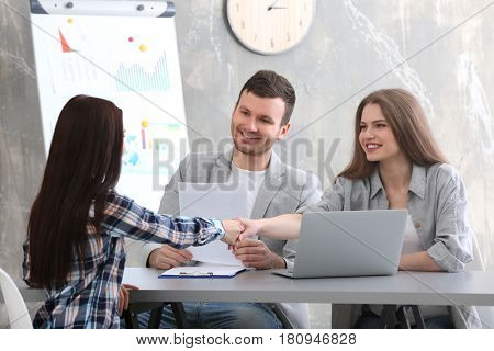 Human resources commission interviewing woman in office