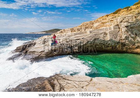Thassos, Greece - May 2, 2016: People near Giola natural sea water pool located on Thassos island, Greece