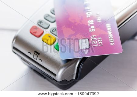 payment terminal and credit card in purchasing concept on stone table background