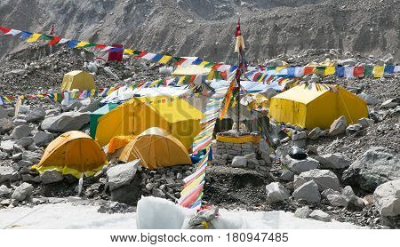 View from Mount Everest base camp yellow tents and prayer flags trek to Everest base camp - Nepal poster
