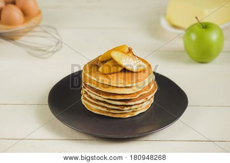 Pancakes with apple on table. Breakfast snacks. Pancakes Day.