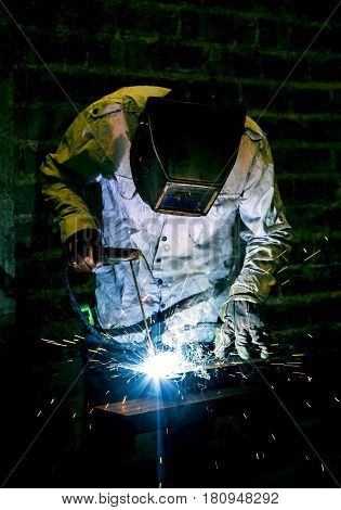 Worker working with welding in the construction industry in the construction industry