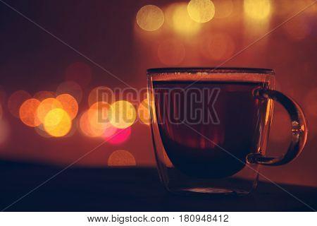 Single tea cup and night city. Nightlife