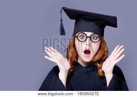 Photo Of Beautiful Young Alumnus In Black Suit On The Wonderful Grey Studio Background