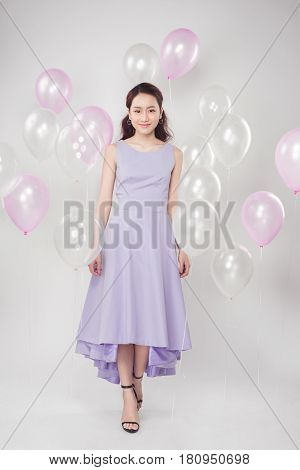 Full-length Of Fashion Photo Of Beautiful Woman With Pastel Balloons.