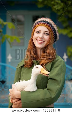Photo Of Beautiful Young Woman With Goose On The Wonderful Building Background