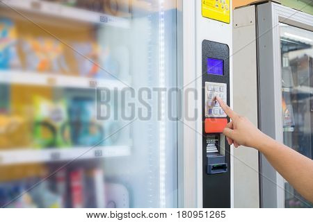 Female Hand Push Button To Make Transaction Code Or Number On Modern Automatic Vending Machine