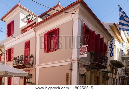 Traditional Rennovated Classical Building And Greek Flags In Nafplion.
