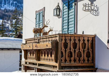 House with balcony at mountain slope in winter. Cortina de Ampezzo. Italy