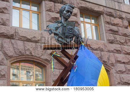 Kiev Ukraine - September 03 2015: Monument to Taras Shevchenko and national symbols near City Hall