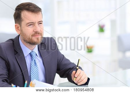 Close-up of businessman smiling. Work in modern office.